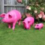 statue cochon en résine rose